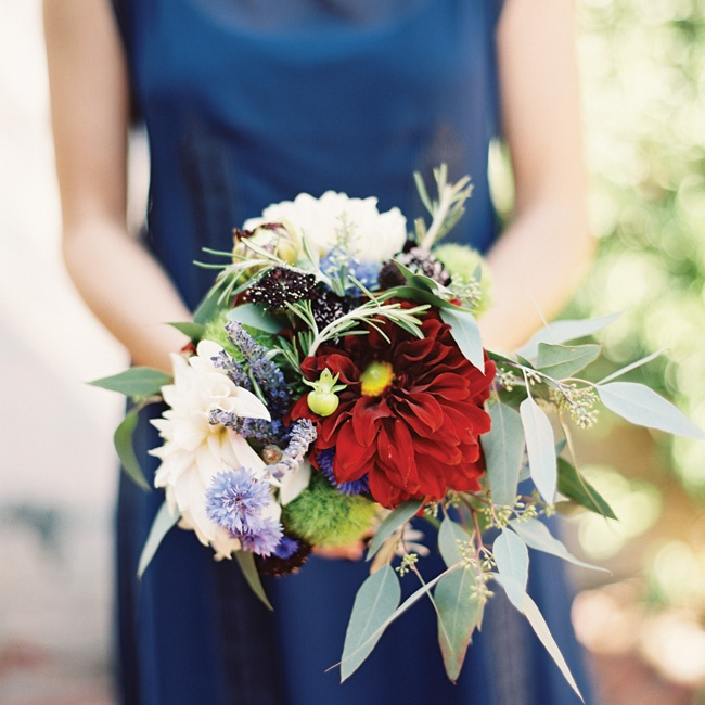The bridesmaids' wild-looking bouquets of burgundy dahlias, lavender, Green Trick dianthus, rosemary and greens popped against their midnight-blue gowns.