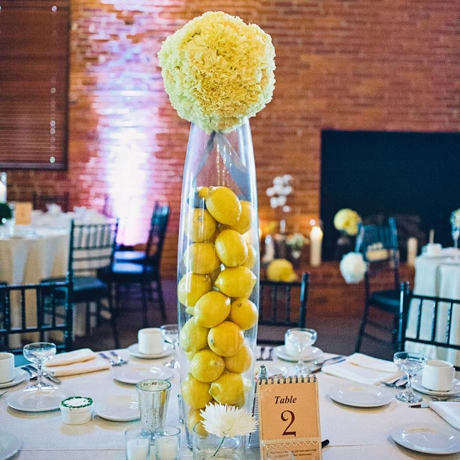 The ceremony pomanders were repurposed for the reception centerpieces and placed atop tall pilsner