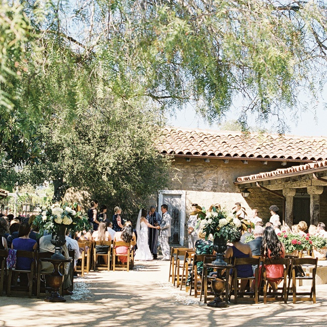 Rachel and John exchanged their vows in the shade of a large tree in a courtyard between two of the