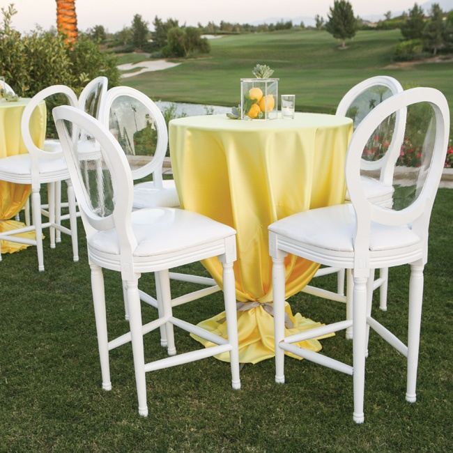 In keeping with the day's laid-back vibe, everyone moved freely between high cocktail tables covered in yellow linens during the reception.