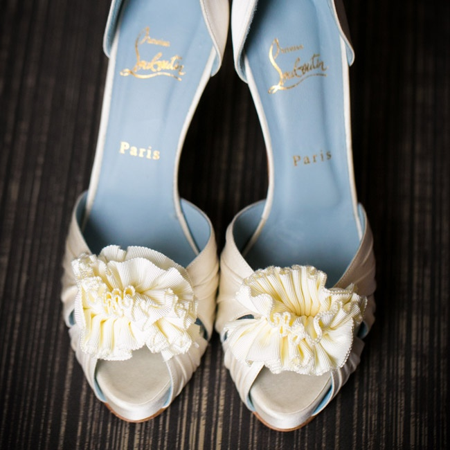 Fabric rosettes added just the right amount of personality to Sofie's ivory peep-toe pumps.