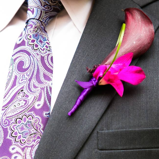 A purple calla lily boutonniere and a paisley tie popped against Tony's charcoal suit.