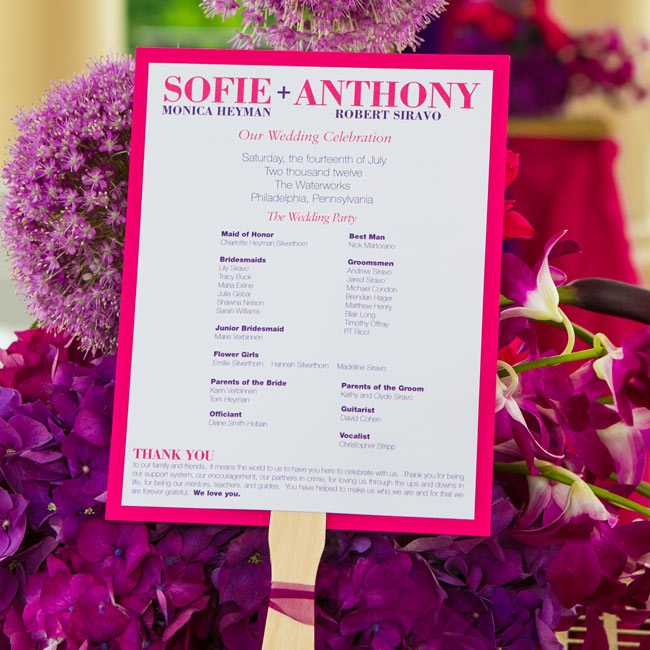 The modern double-sided ceremony programs were mounted on fuchsia card stock, and the wooden handle meant they could double as fans too.