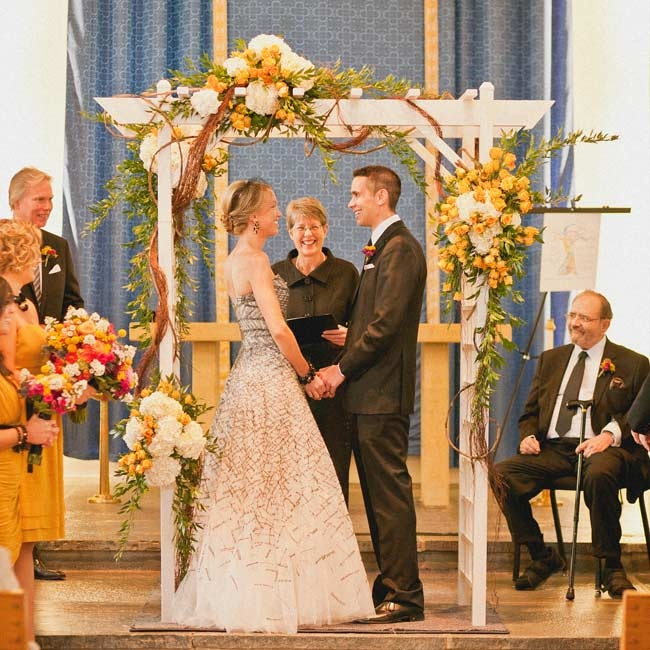 The couple were married beneath a rustic huppah draped in natural roots.