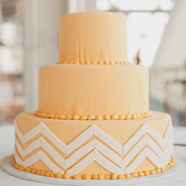 """Kristin says her obsession with chevron inspired their fondant-covered cake. """"I didn't want to overdo it, so it was only on the bottom tier,"""" she adds."""