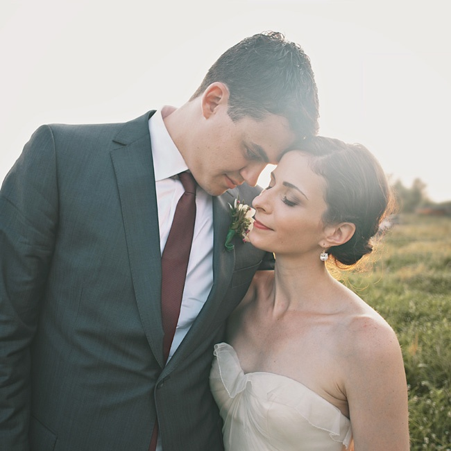 Amanda loved the vintage feel of her ivory organza gown. Nick looked stylish in a dark-gray suit and a thin cranberry tie.