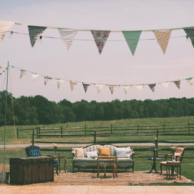 """A vintage outdoor """"living room"""" was set up beside the dance floor beneath strings of pennant flags Amanda made herself."""