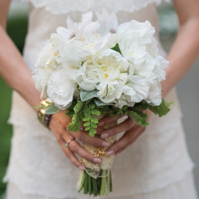 Devin's bouquet was made up of white roses, lisianthus and sweet peas with maidenhair