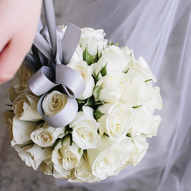 The flower girl (Whitney's niece) carried a pomander of white spray roses that dangled from her wrist on a ribbon.
