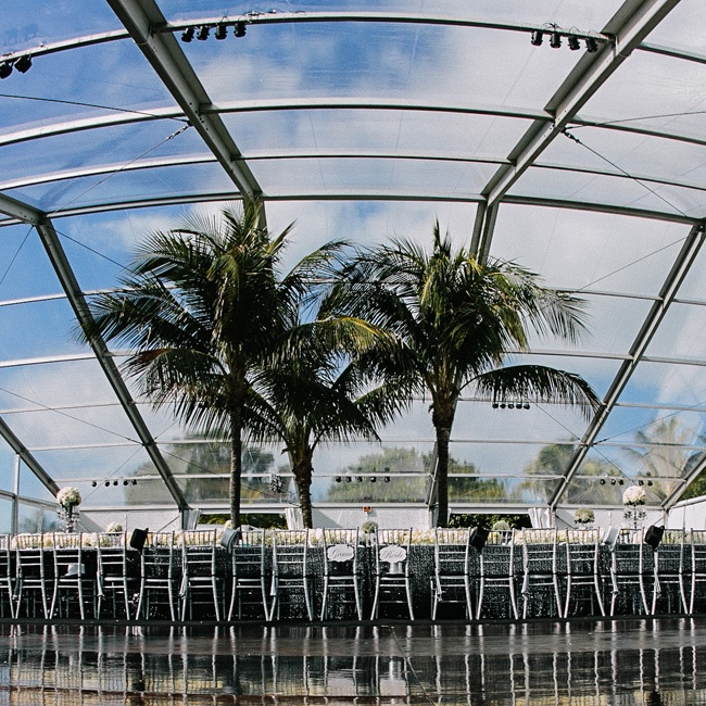 The clear span tent was large enough to fit a guest list of 300 and live palm trees.