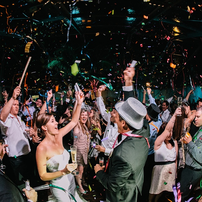 """We didn't have a grand exit because it was New Year's Eve - We stayed and partied the night away until 1:30 a.m.!"" Whitney says. When the ball dropped, ""we did every confetti thing you could imagine,"" she adds."