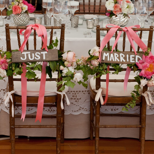 'Just Married' signs adorned the back of Laura and Rich's chairs.