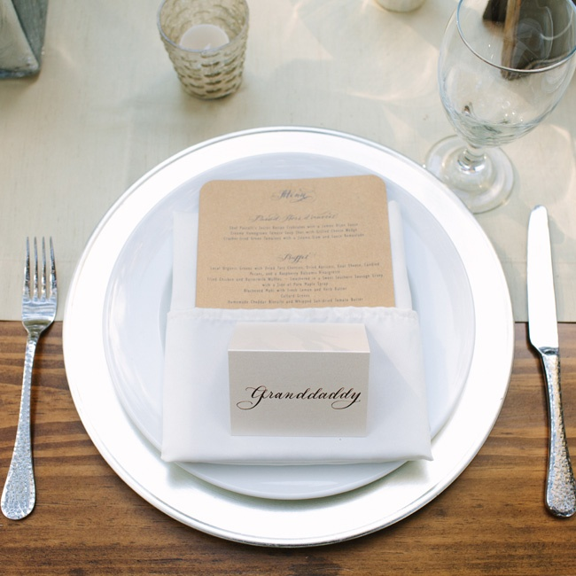 White and silver place settings let the simple beauty of the wooden tables shine through, while a