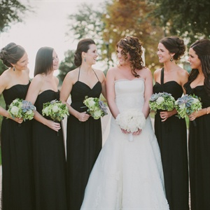 """I never thought I wanted black bridesmaid dresses, but it was so elegant and sophisticated,"" Sandi says, adding that the all-green bouquets really stood out against the dresses."