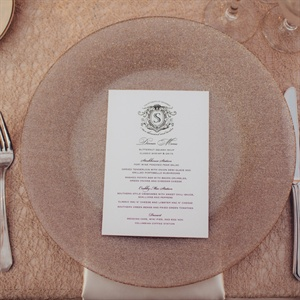 Colors like cream, ivory and champagne were used throughout the décor. Champagne-colored linens were topped with coordinating chargers, creating a look that was both classic and modern.