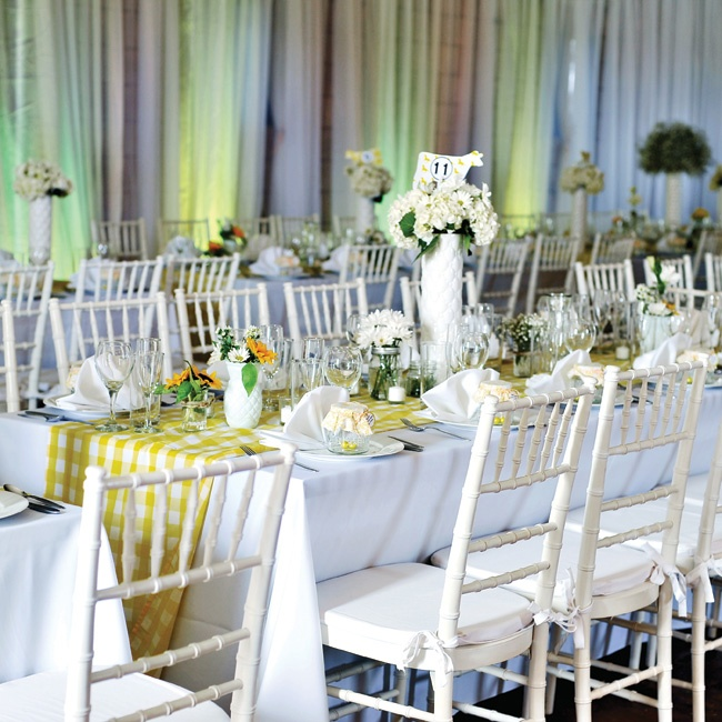 Tall vases, filled with either baby's breath or white hydrangeas,