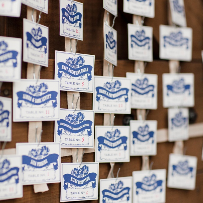 The vintage letterpress escort cards were draped across the barn door