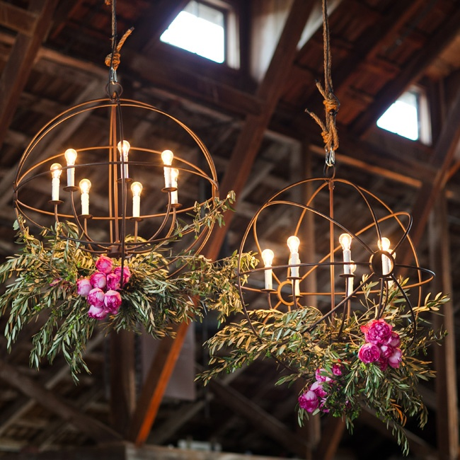 Two large iron orbs, draped in flowers