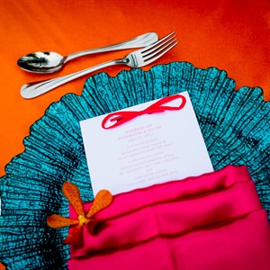 Bright Aqua Charger Plates and Papaya Table Linens