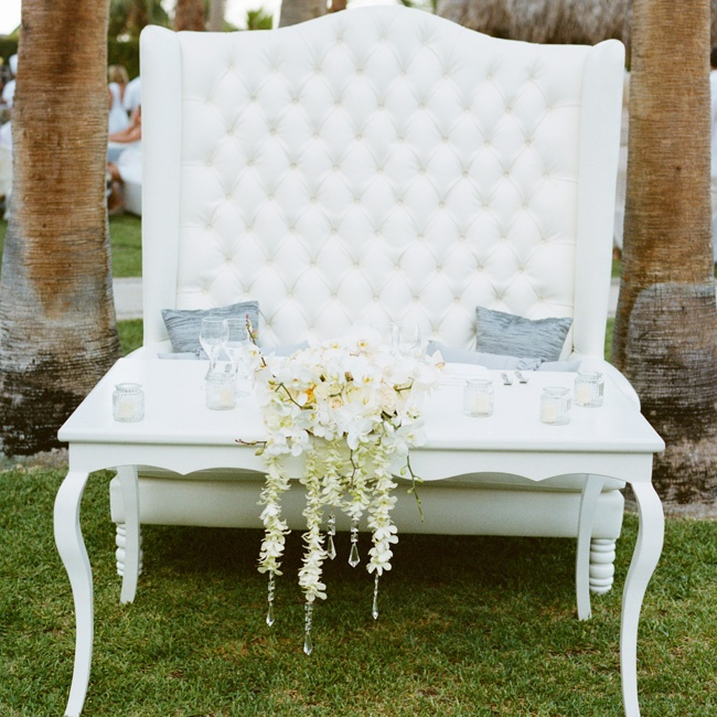 A mix of high-back baroque chairs and sleek modern tables decorated the cocktail-hour and reception spaces.