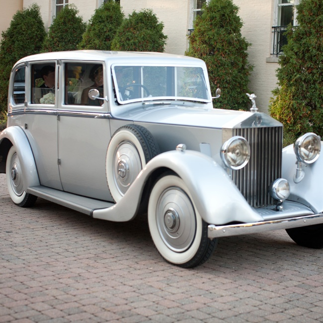The couple traveled to the reception in style—in a silver vintage Rolls-Royce.