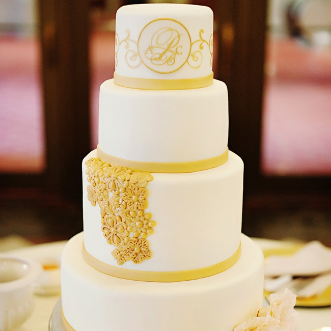 The ivory and gold cake matched the day's elegant color palette.