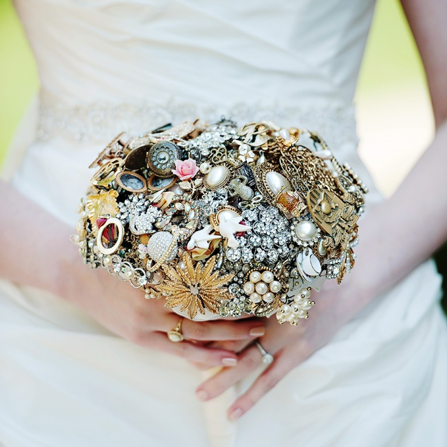 """Caitlin carried a brooch bouquet that included family heirlooms and individual charms that each hold a special meaning for her. """"The best part is that I'll have it forever— it's probably the greatest collection of memories I'll ever have,"""" she says."""
