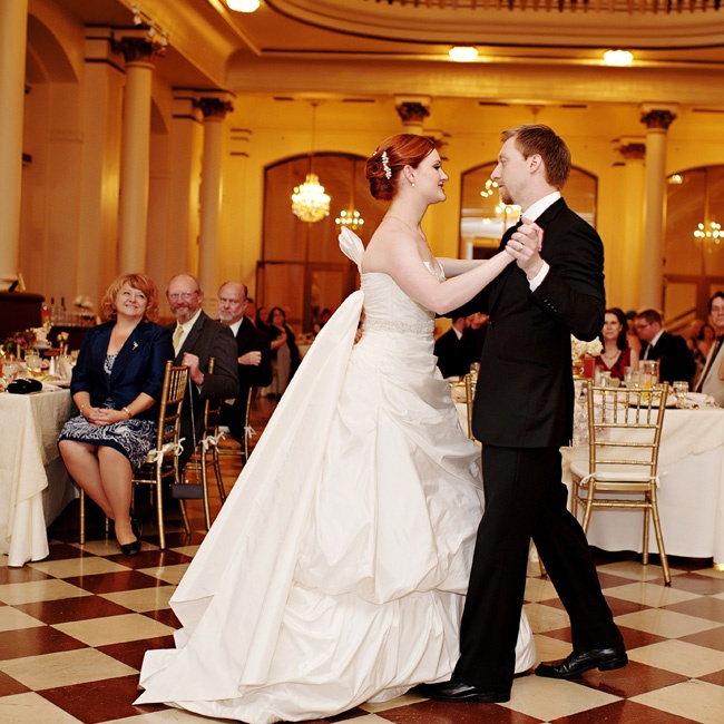 """Caitlin and Andy's first dance was to """"A Kiss to Build a Dream On"""" by Louis Armstrong."""