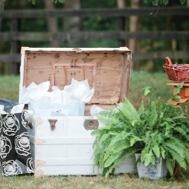 Guests placed wedding gifts in and around an antique wooden