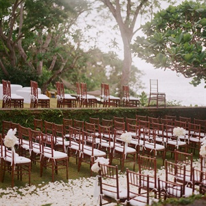 Bethany and Olivier were married in an intimate sunken garden drenched in white orchids, hydrangeas, calla lilies and rose petals.