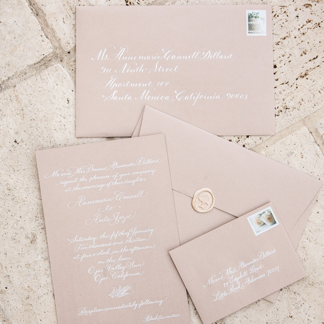 The elegant invitations were engraved in subtle white ink. For an impressive final detail, the envelopes were sealed with wax.
