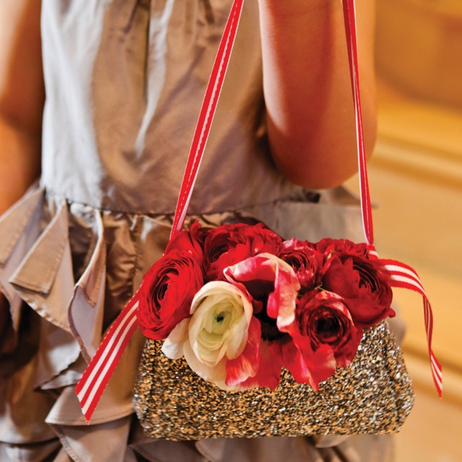 Allie's three-year-old goddaughter, Samantha, took her duties very seriously. She (carefully) carried a glittery purse filled with red and white blooms down the aisle.