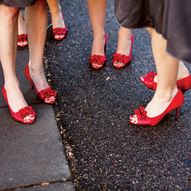 Allie's six bridesmaids all wore not just the same charcoal-gray knee-length dress, but also the same flirty bright red heels.