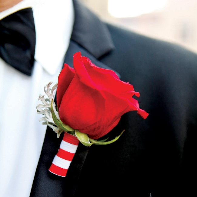 Classic red-rose boutonnieres, accented with dusty miller, gave the guys a pop of color; stems wrapped in striped ribbon added a whimsical touch. The fellas looked dapper in traditional black tuxes with ivory shirts and black bow ties, suspenders and cummerbunds.