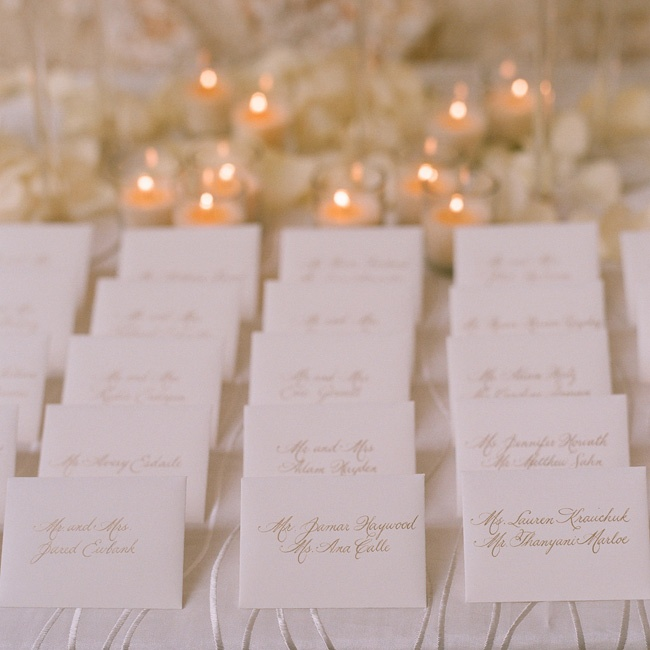 Traditional hand-calligraphed cards were slipped inside matching white envelopes.