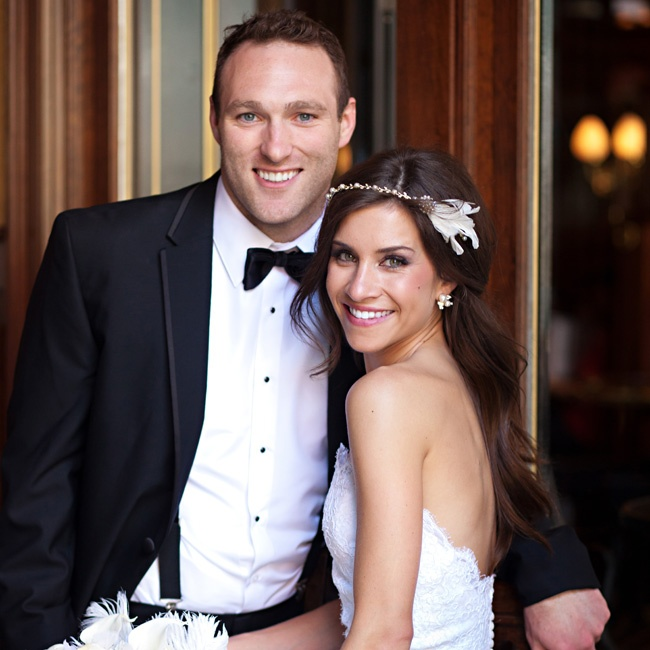"""""""I tried it on and was sold!"""" Corey recalls of her strapless lace gown. Brian wore a classic black tuxedo complete with a bow tie and suspenders."""