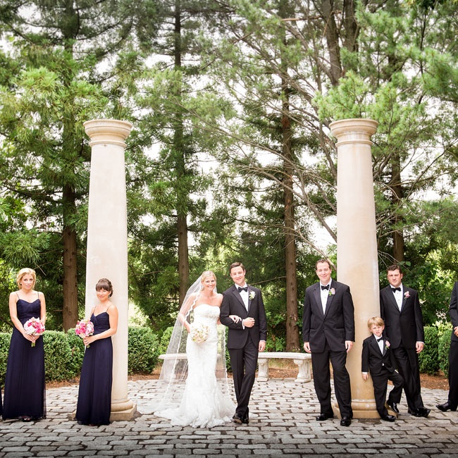 The bridesmaids carried bouquets of pink garden roses, pink freesia, white hydrangeas and pink lisianthus, which popped against their navy chiffon dresses. The guys all wore freesia boutonnieres: Aaron's was white and the groomsmen's were pink.