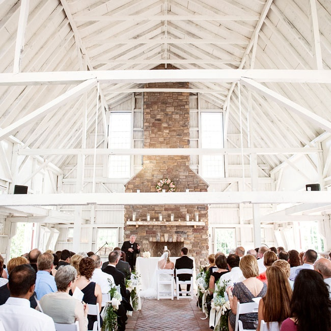 The couple chose The Ashford Estate because they could have the entire venue to themselves, and it was important to Lauren and Aaron to honor their New Jersey roots by getting married in their home state. The ceremony took place in a rustic barn, which has exposed wood beams and a stone fireplace. The brick herringbone floor created a dramatic aisl ...