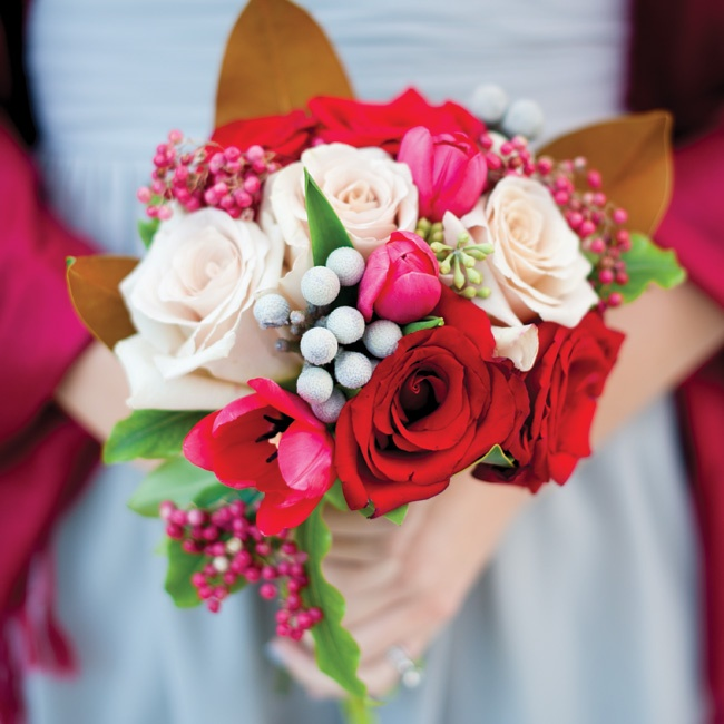 The bridesmaids held textured bunches of silver brunia, roses and hypericum berries.
