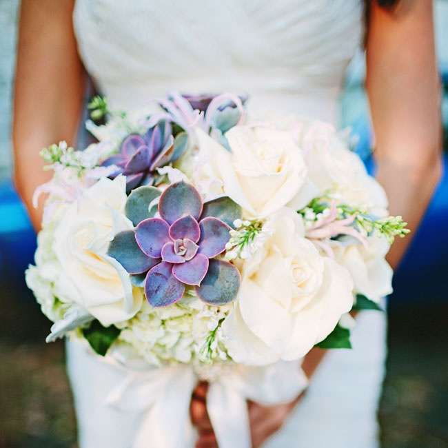 The florist added succulents to Elaine's champagne- and cream-colored rose bouquet to fulfill the bride's request for purple.