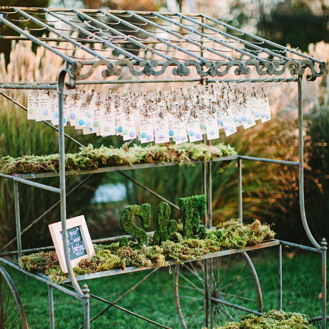 "The escort cards were a DIY project. ""I had a friend's mother write out all the guests' names on shipping labels and ordered custom button pins through Etsy to hot glue onto each card,"" Elaine explains."