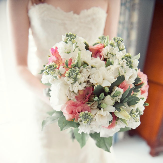 """I really wanted peonies in my bouquet,"" Carly explains, ""but they were out of season. Instead, I had ivory, light pink and peach flowers, including roses."""