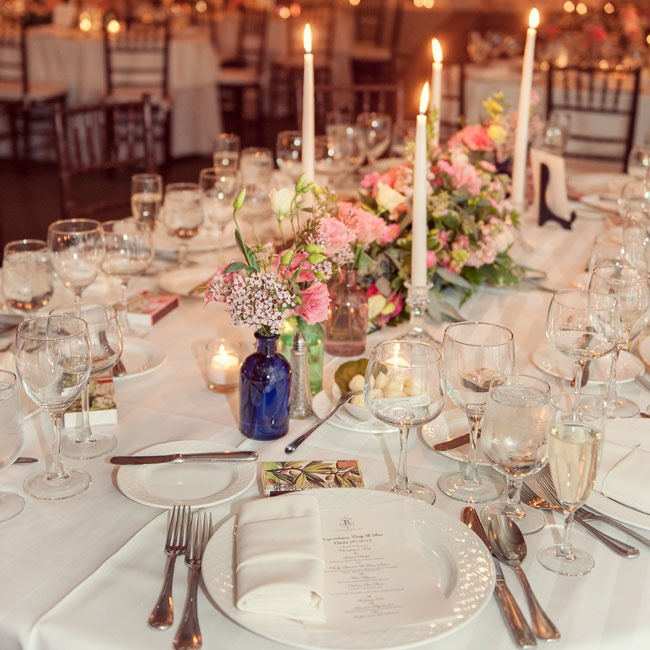 Centerpieces were flanked by vintage glass bottles.