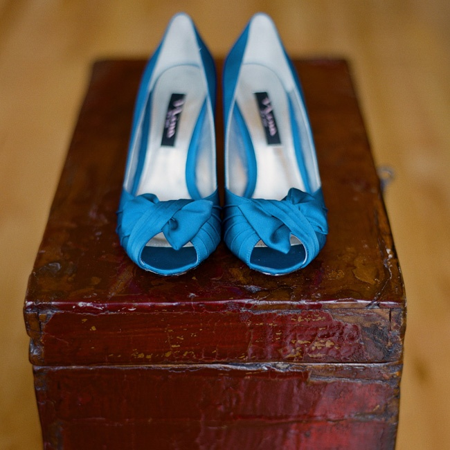 "For her ""something blue,"" Cory wore a pair of royal blue satin peep-toe pumps."