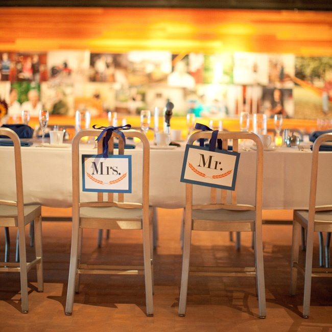 The new Mr. and Mrs. John Butler's chairs were decorated with DIY signs at the