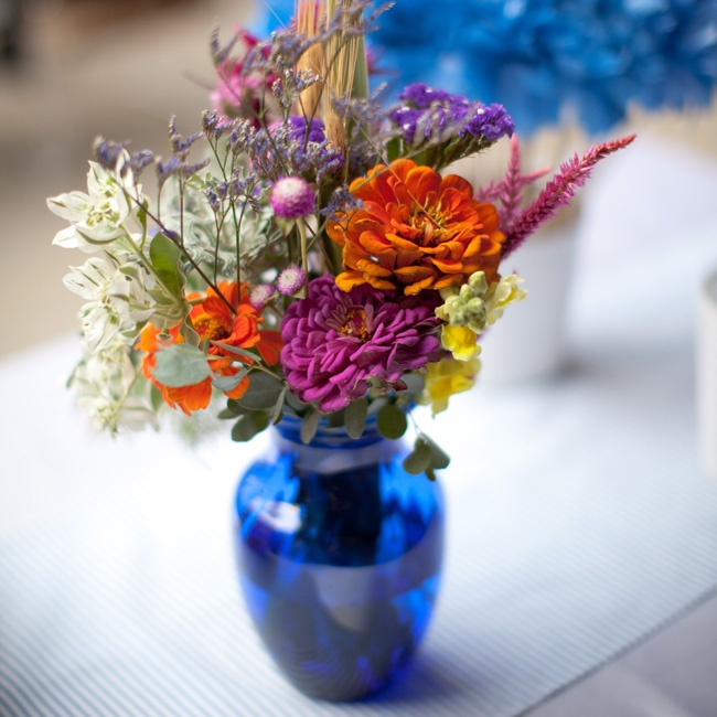"""The venue itself has a lot of visual interest, so we kept our centerpieces simple,"" Cory says of the
