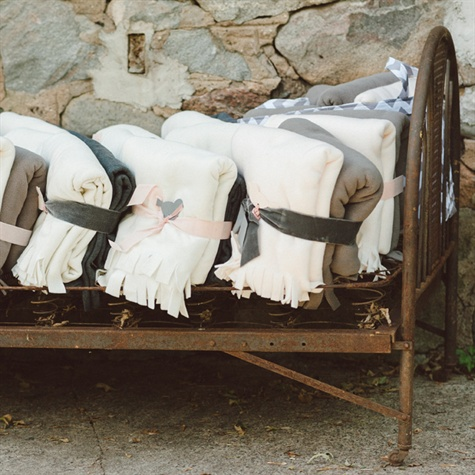 Warm Blanket Favors Displayed on an Antique Bed