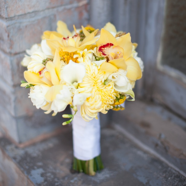 Emily carried a bouquet of yellow and cream flowers to stand out against