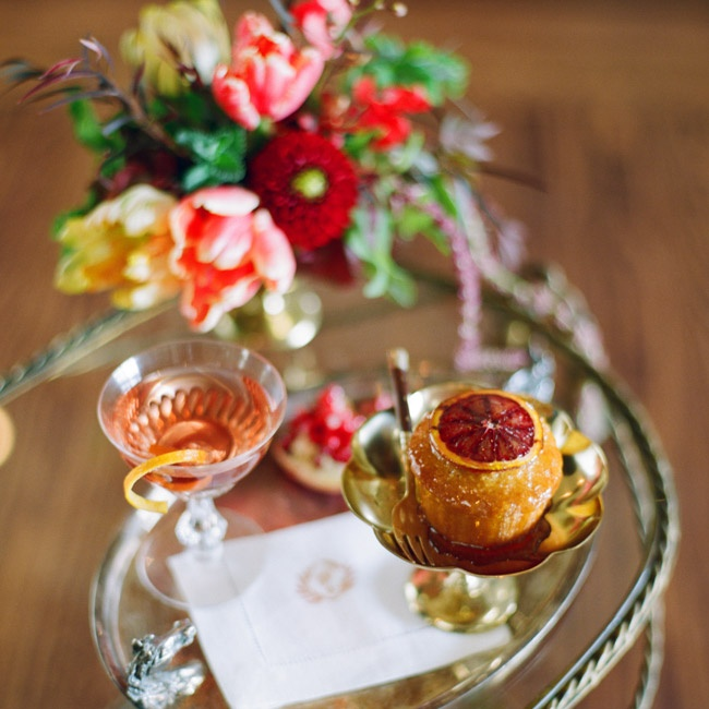 Wine and desserts can be seen as art when decked out in the right accessories, like this lemon cake topped with a slice of honey-drizzled blood orange and served in gold stemware alongside rosé in an etched glass. Glass, AndGeorge.com; catering, PippinHallFarm.com