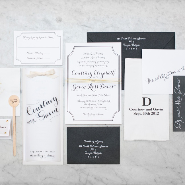 """Courtney's job as an invitation designer made coming up with her stationery suite much harder than she anticipated. In the end, she created a simple black-and-white design with a gold thread wrapped around the middle. """"My favorite part was the white calligraphy on the black envelopes,"""" she says. """"There's just nothing like amazing calligraphy."""""""
